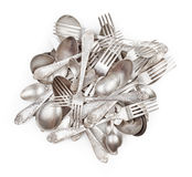 Pile of aged vintage silver cutlery. (forks, spoons, knifes) isolated on white background Royalty Free Stock Images