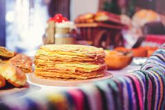 Pile of air pancakes on a wooden dinette, a traditional food family. pancakes of golden color Stock Photo