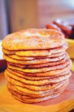 Pile of air pancakes on a wooden dinette, a traditional food family. pancakes of golden color Stock Photography
