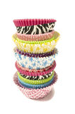 Pile of all colors cupcake paper cups. Royalty Free Stock Images