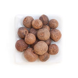 Pile Allspice (jamaica pepper) in a white bowl stock images