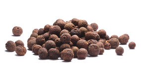 Pile of allspice-Pimenta dioica fruits, paths. Pile of allspice peppercorns dried fermented fruits of Pimenta dioica. Clipping paths, shadow separated royalty free stock photos