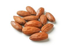 Pile of almond nuts on white background. Pile of glossy almond nuts on white background royalty free stock photo
