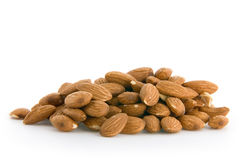 Pile of almonds. Isolated on white Stock Image