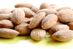A pile of almonds #4. A pile of almonds againsta a yellow background royalty free stock photo