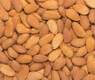 Pile of almonds close-up as background. Royalty Free Stock Image