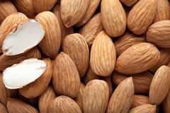 Pile of almonds close-up as background. Royalty Free Stock Photo