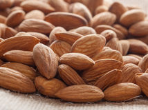 Pile of almonds close-up as background. Stock Images