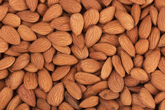 Pile of almonds close-up as background. Food texture Stock Photography