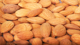 Pile of almonds close-up as background. Stock Photography