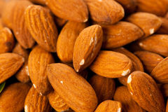 Pile of almonds close-up as background or texture. Stock Photos