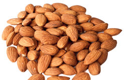 Almonds. Pile of almonds on a white background Royalty Free Stock Photos