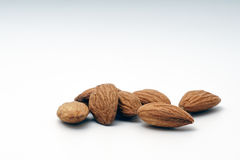 Pile of almonds on a white background. Pile of almonds on a white  background Stock Photo