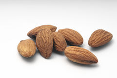 Pile of almonds on a white background. Pile of almonds on a white isolated background Stock Image
