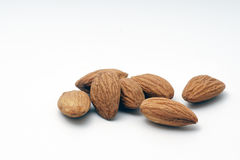 Pile of almonds on a white background. Pile of almonds on a white isolated background Stock Photo