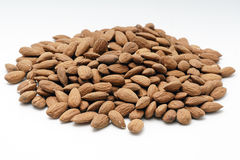 Pile of almonds on a white background. Pile of almonds on a white isolated background Royalty Free Stock Photo