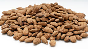 Pile of almonds on a white background. Pile of almonds on a white isolated background Stock Images