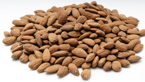 Pile of almonds on a white background. Pile of almonds on a white isolated background Stock Photography