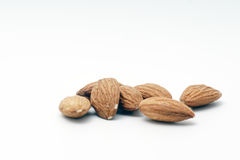 Pile of almonds on a white background. Pile of almonds on a white isolated background Royalty Free Stock Images