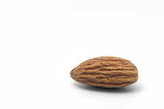 Pile of almonds on a white background. Pile of almonds on a white isolated background Stock Photos