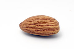 Pile of almonds on a white background. Pile of almonds on a white isolated background Royalty Free Stock Photos
