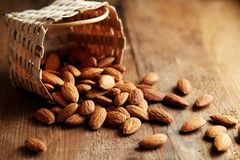 A pile of almonds on a wooden surface Royalty Free Stock Photo