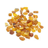 Pile of amber beads isolated on the white background Royalty Free Stock Photos