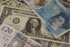 Pile of American and British currency Royalty Free Stock Image