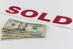 Pile of AMerican money with sold sign Royalty Free Stock Photos