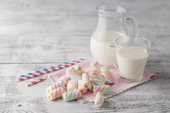 Pile of american twisted marshmallow on table with glass of milk Stock Photography
