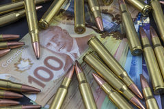 Pile of ammo on Canadian Money royalty free stock images