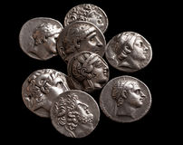 Pile of ancient silver greek coins top view stock photo