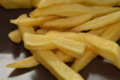 A pile of appetizing french fries. On  a brown plate Stock Photos