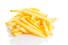 A pile of appetizing french fries isolated. On a white background Stock Photos