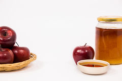 Pile of apples and red apple and jar of honey bowl of honey isol Royalty Free Stock Images