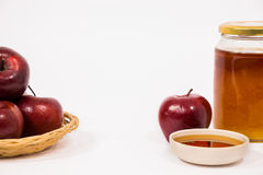 Pile of apples and red apple and jar of honey bowl of honey isol Royalty Free Stock Photo