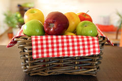 Pile of apples in wicker basket Stock Image
