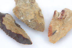 Pile of arrowheads. Macro image of a flint artifact Royalty Free Stock Image