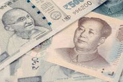 Pile of asian leading development countries, emerging market mon. Ey banknotes, indian rupee, chinese yuan, searching for yield in alternative market concept royalty free stock image