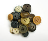 Pile of Assorted Dark Buttons Isolated on White royalty free stock image