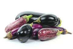 Pile assorted Eggplants on white. Royalty Free Stock Photos