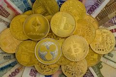 Pile of assorted gold cryptocurrency coins Stock Photos