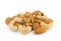 Pile of assorted nuts close up. Isolated on white background Stock Photos