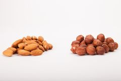 Pile of assorted nuts on white. Background stock photos