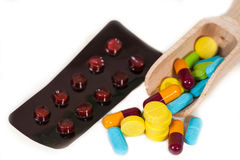 Pile of assorted pills, tablets and drugs on white Royalty Free Stock Image