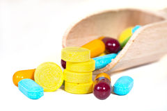 Pile of assorted pills, tablets and drugs on white Royalty Free Stock Photos