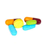 Pile of assorted pills, tablets and drugs on white Stock Photo