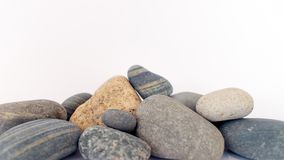 A pile of assorted smooth sea rocks Royalty Free Stock Image