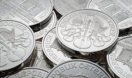 Pile of Austrian Silver Vienna Philharmonic coins. Stock Photo