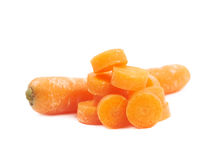 Pile of baby carrot slices isolated Stock Images